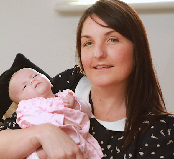 Mum delivers baby home alone... then saves her life minutes later!