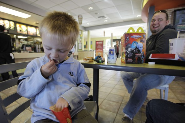 Child and father in McDonald's
