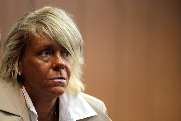 Critics are 'jealous, fat and ugly' says tanorexic mum accused of burning her five-year-daughter in tanning booth