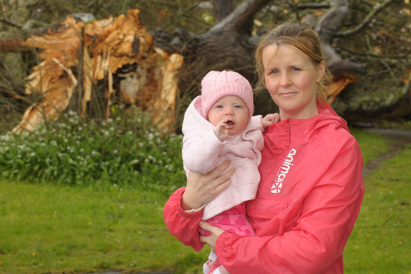 Mum and baby cheat death after 70 foot tree crashes onto roof during early morning feed