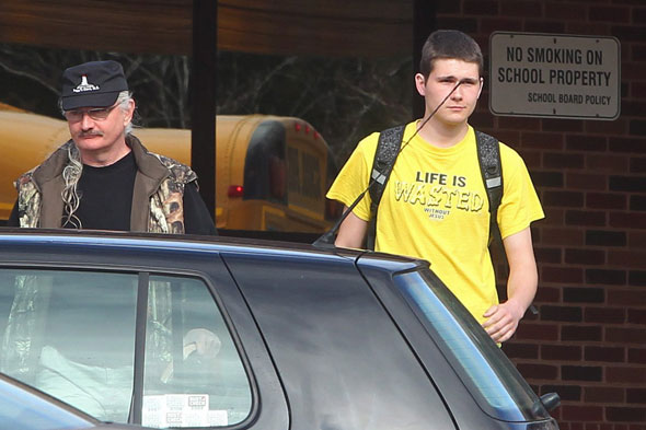 William Swinimer and father: Jesus t-shirt boy pulled out of school by angry dad