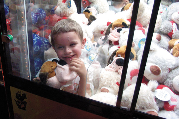 A little help please? Another toddler gets stuck in a toy machine