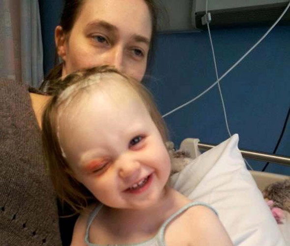 A millimetre from tragedy: Toddler survives falling onto a pencil which pierced her eye socket and lodged in her brain!