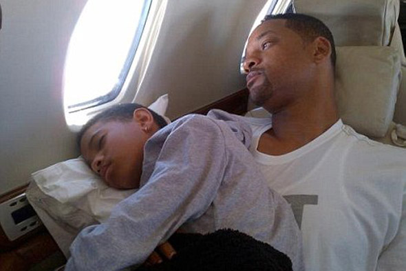 Willow Smith finally acts her age by falling asleep on her dad's knee