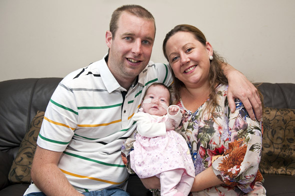 Mum who was told her baby had died in the womb brings home healthy daughter