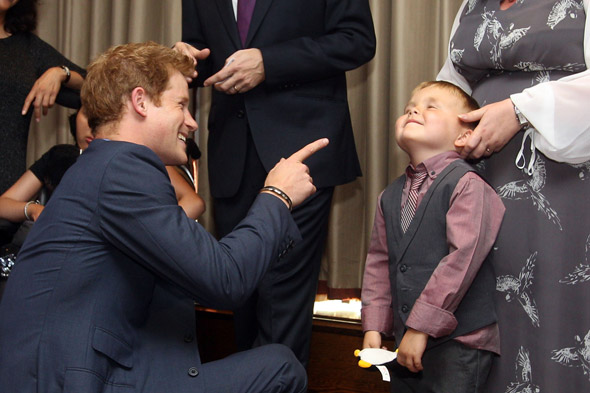 Prince Harry puts Vegas scandal behind him...by bonding with some children