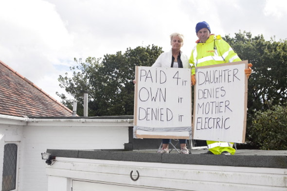 Granny stages roof top protest after fall out with daughter over electricity bill