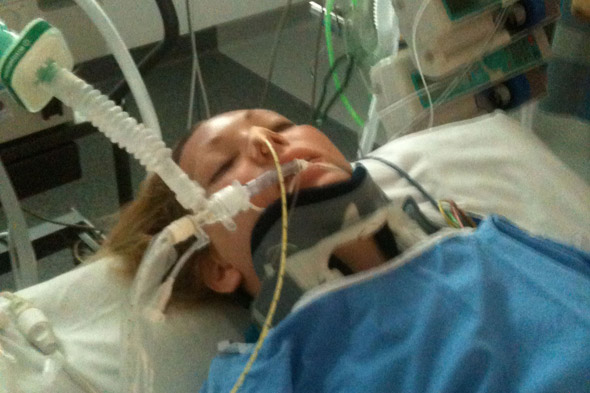 Woman who broke her back and neck wakes from coma to give birth to surprise baby
