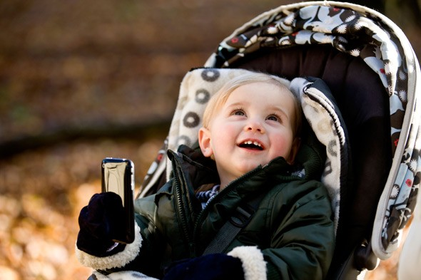 Thief snatches iPhone from baby's hands as she watches Barney the Dinosaur in her pram