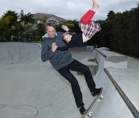 Skateboarding legend Tony Hawk defends performing stunts with 4-year-old daughter without a helmet