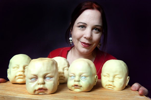Life-size chocolate baby heads on sale