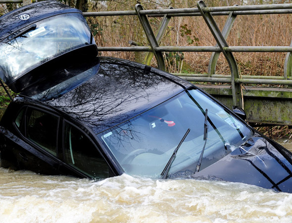 Mum and three kids dramatically rescued from raging river by lost workmen