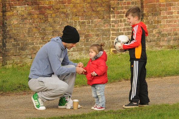 Hands-on dad David Beckham takes over childcare duties while Victoria attends London Fashion Week
