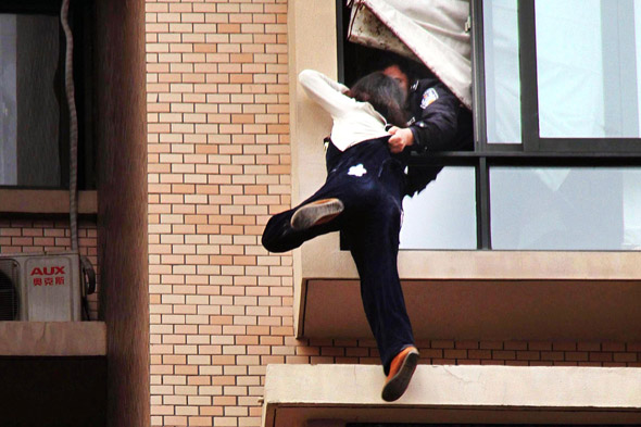 Incredible pictures: Policeman saves pregnant woman from jumping to her death