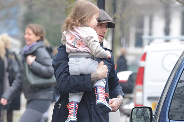 These boots were made toddling: Harper Beckham toddles around in Marc Jacobs wellies