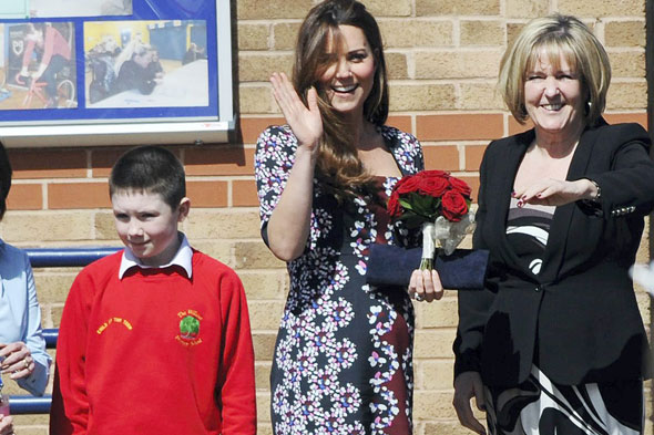Pregnant Kate Middleton finally shows of her growing bump on school visit