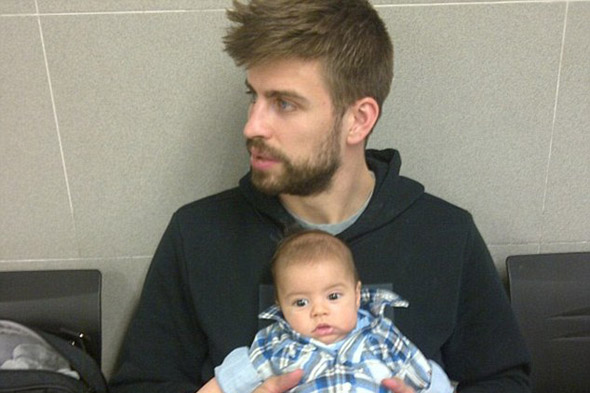 Straight face please! Shakira and Gerard Pique's baby Milan poses for his first passport photo