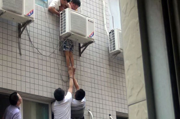 Miracle escape as boy falls from flats and get stuck behind air conditioner