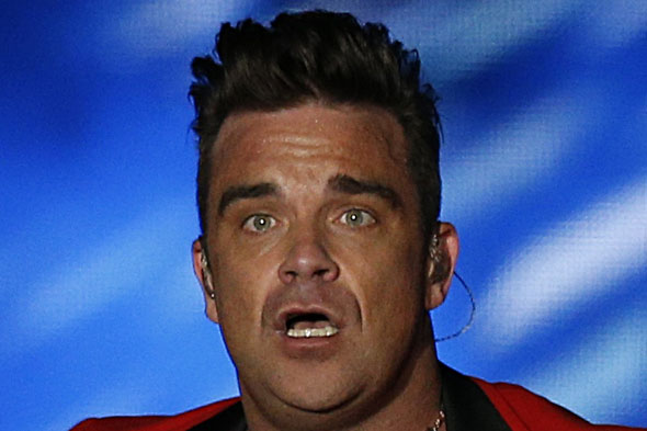 Robbie Williams says he is 'dad-sized' but happy