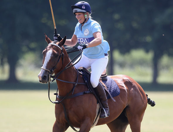 Take things easy? Not a chance. Pregnant Zara Phillips shows bump for first time as she plays POLO!
