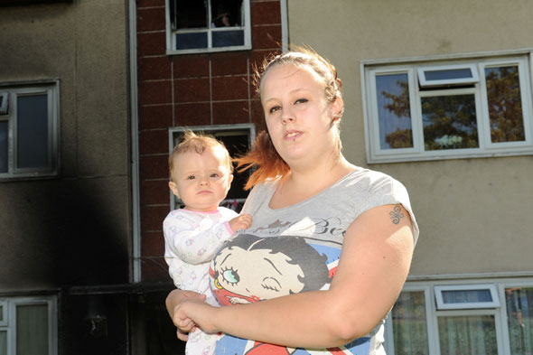 Mum throws baby into arms of stranger as fire breaks out