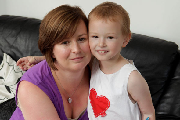 Little girl's arm is cut off for cancer op - and then sewn back on