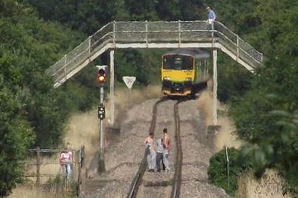 Staggering idiocy of teens playing chicken with speeding train