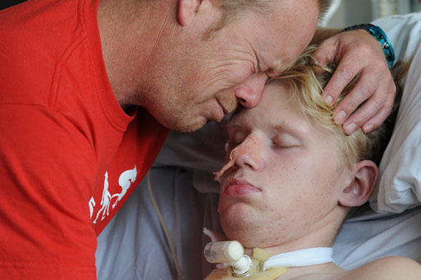 Teenager in coma after refusing to ruin his hair with a cycle helmet