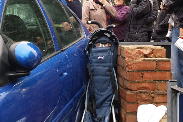 Miracle escape for toddler after car crushed buggy against wall