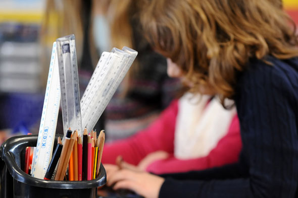 Schools are 'teaching on the cheap' by using classroom assistants to take lessons