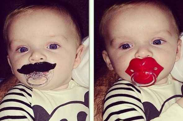 He's no dummy! Baby Klay Rooney follows trend for comedy pacifiers