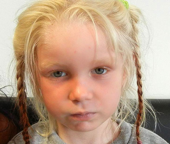 Reunited: Blonde girl, 7, taken into care IS the daughter of gypsy parents