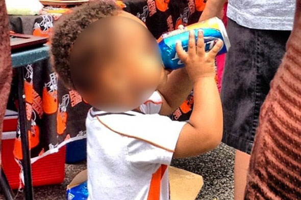 'Starting early these days'. Photo of toddler drinking from can of beer goes viral