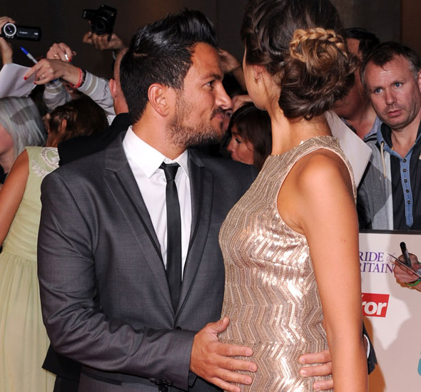 Peter Andre shows off girlfriend's baby bump on red carpet