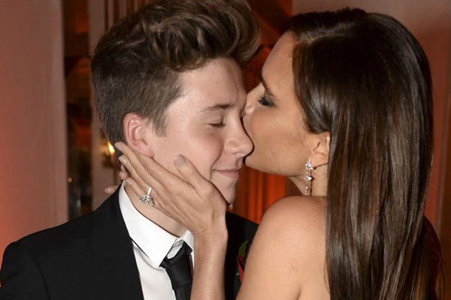 'Not in public, mum, please!' Victoria Beckham kisses 14-year-old Brooklyn