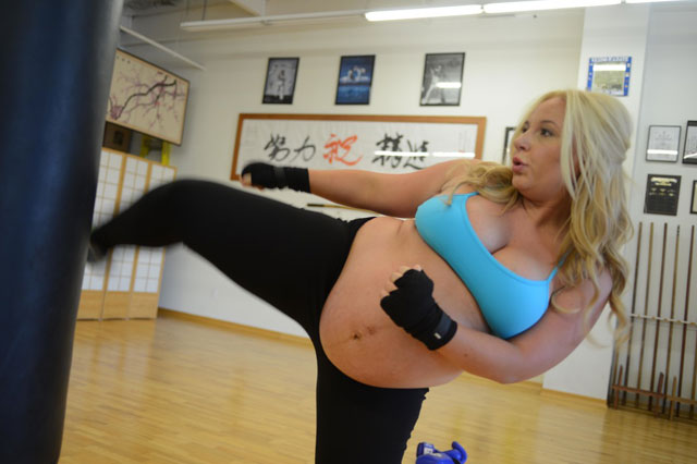 Kickboxing mum is just four weeks away from giving birth