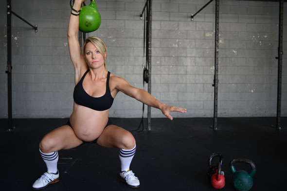 Weight lifting mum delivers her own baby - three weeks late!