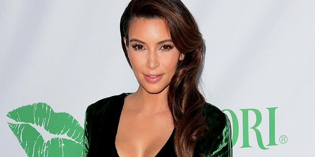 KIM KARDASHIAN WOWS IN GREEN DRESS FROM THE FRONT... BUT COMES UNDONE AT THE BACK